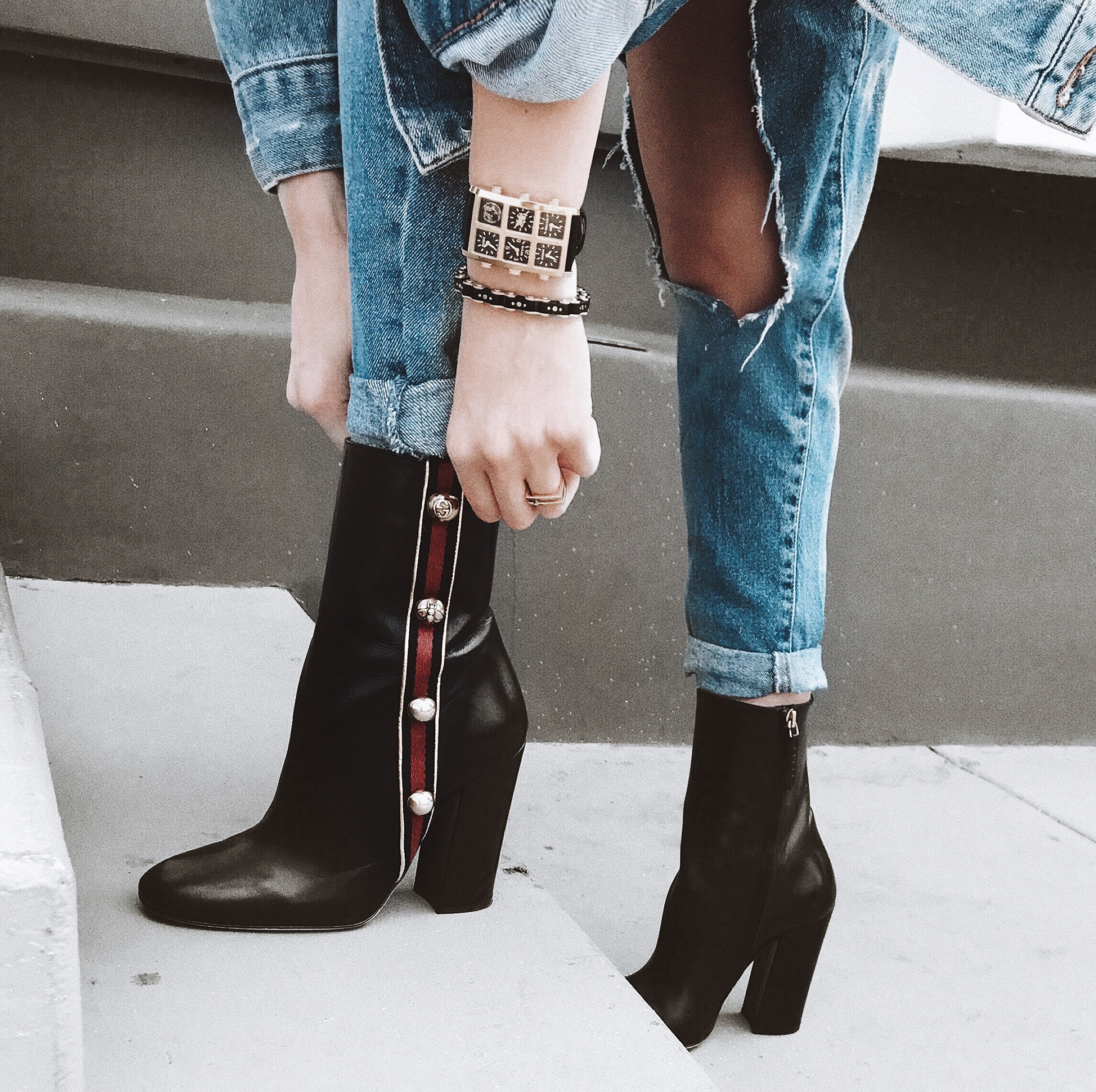 Wearing Lee 40mm Multi-Time Zone Watch pulling up boots