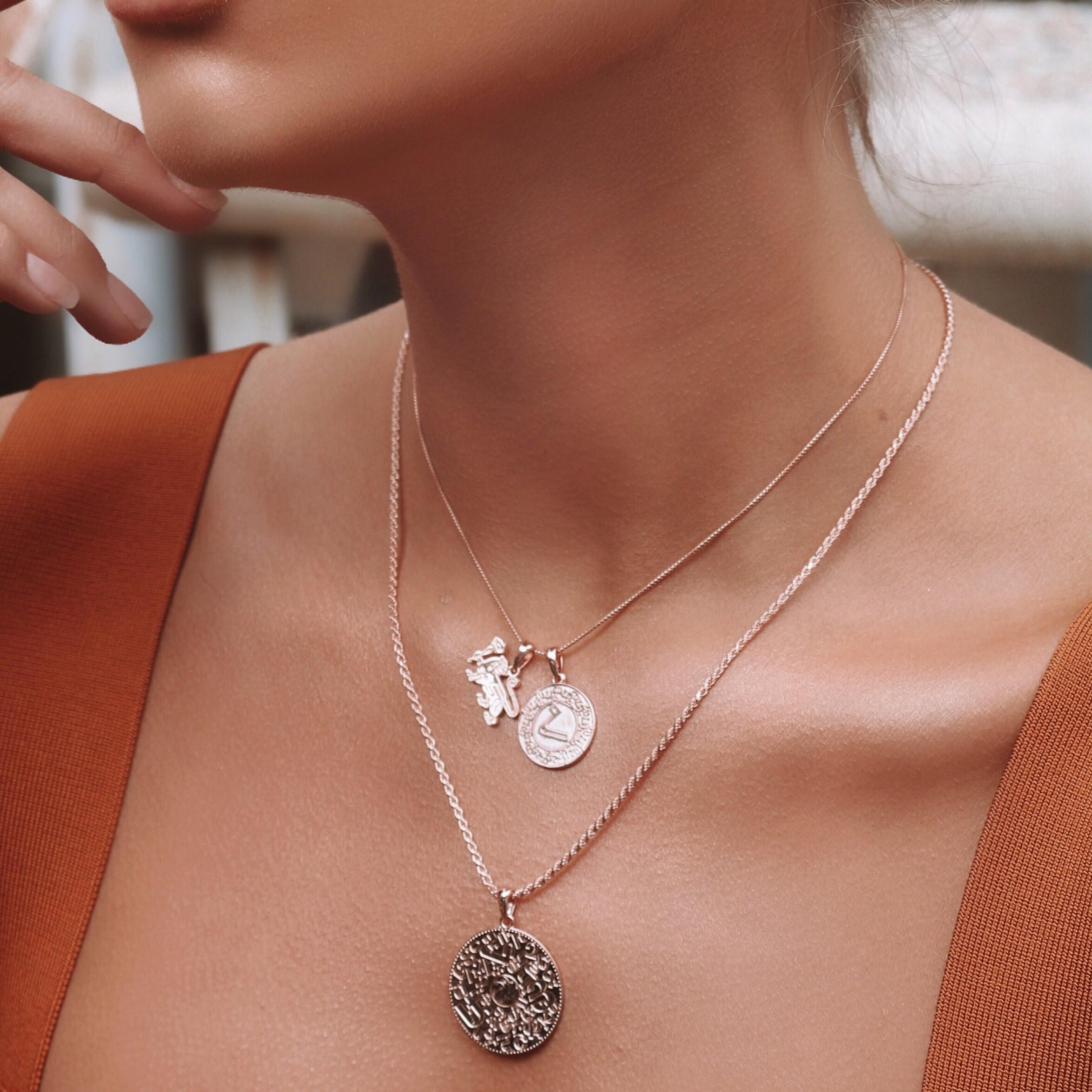 Woman wearing Rose Gold Armenian Alphabet Necklace