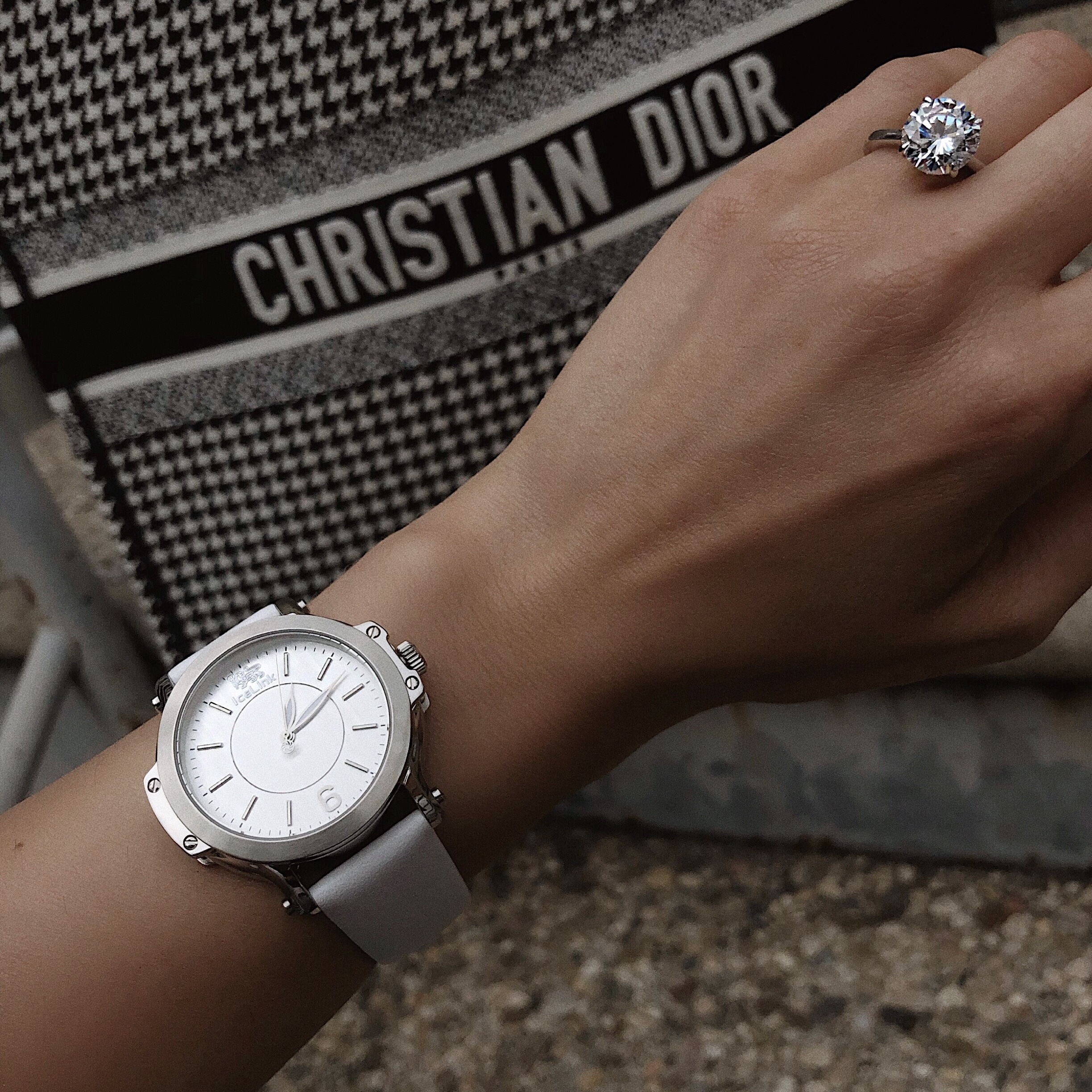 Close up of silver Steel & White Watch on woman's wrist