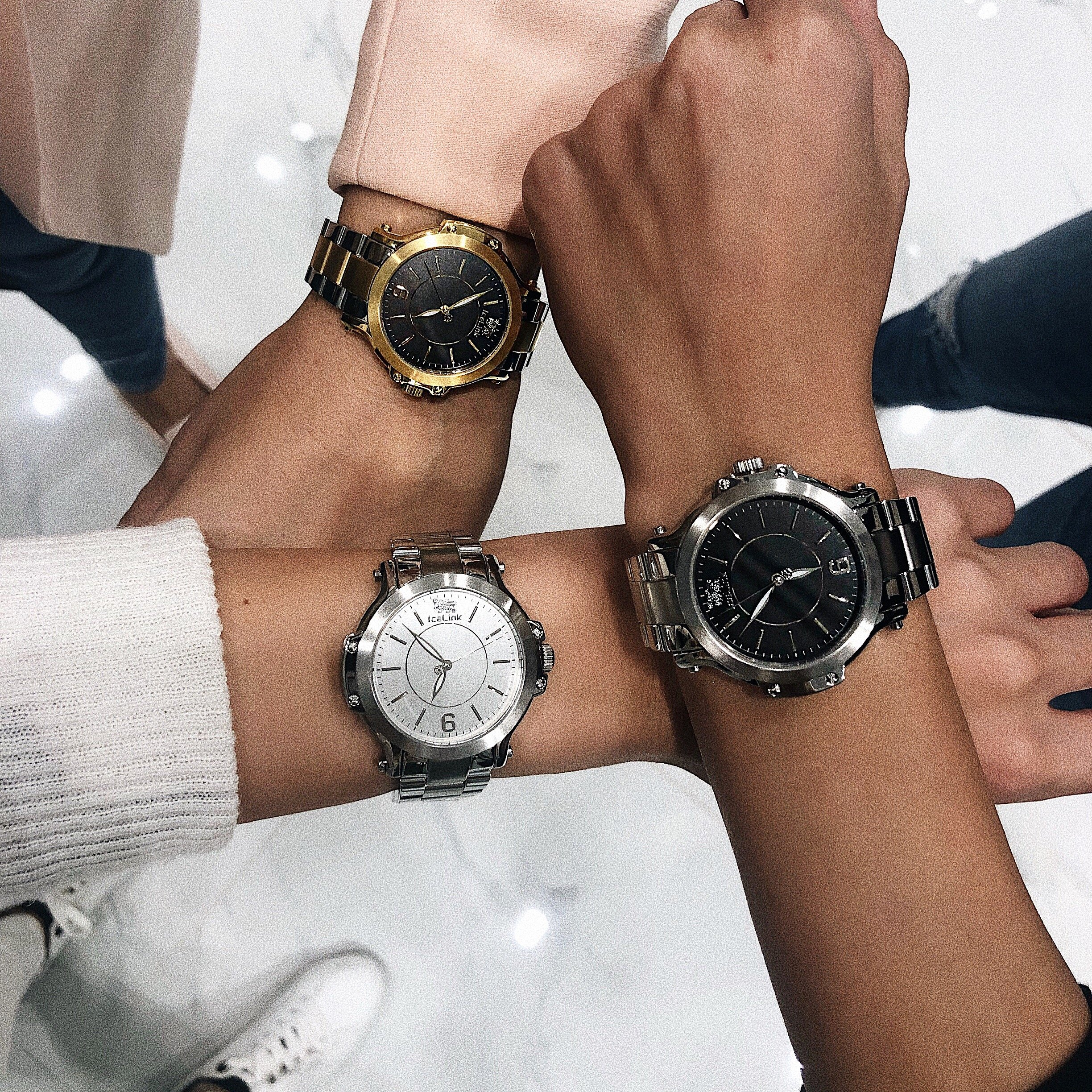 Three arms showing different finishes for the Steel & White Watch