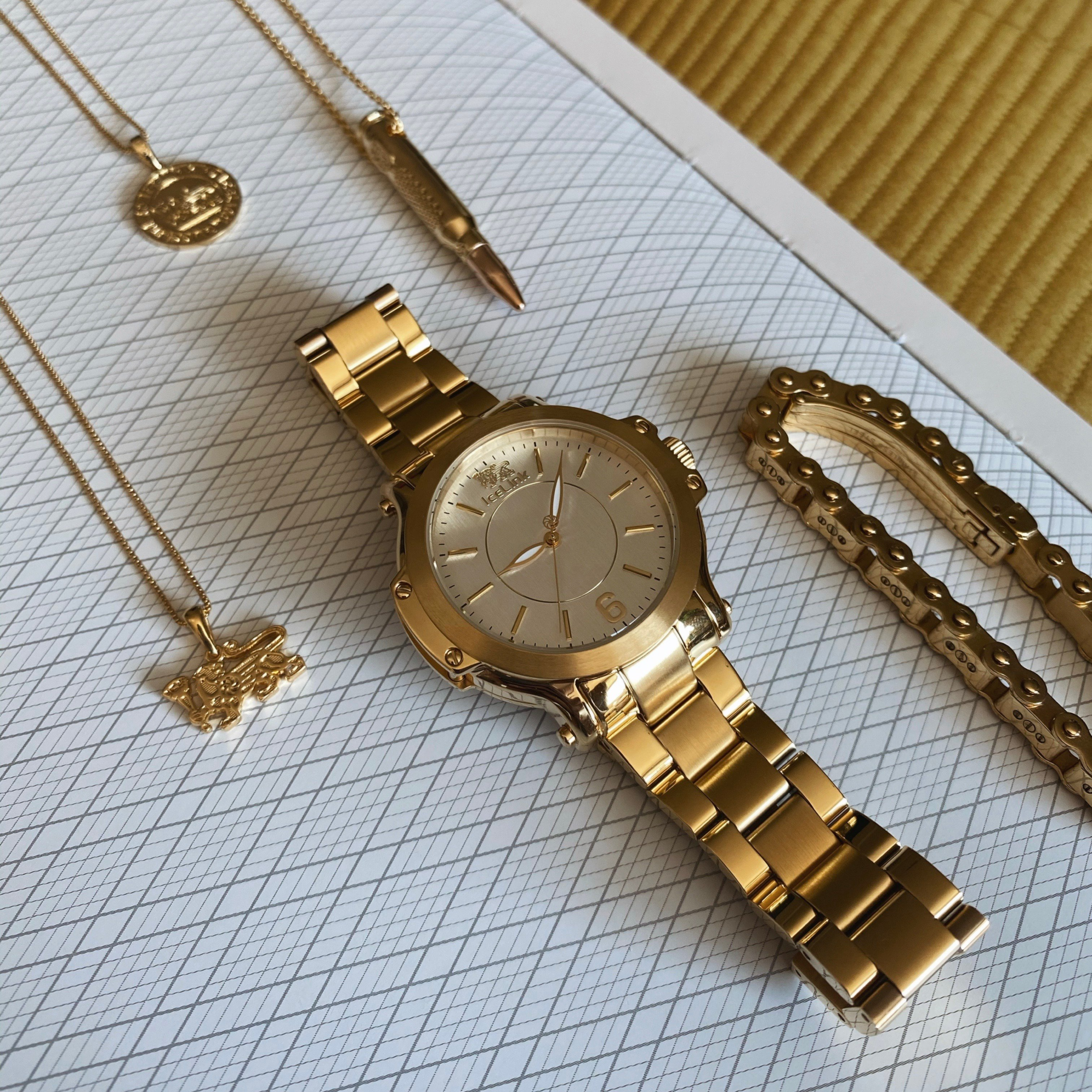 Gold & White Watch arranged on display