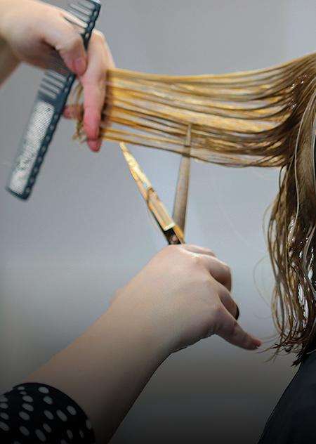 stylist cutting blonde hair