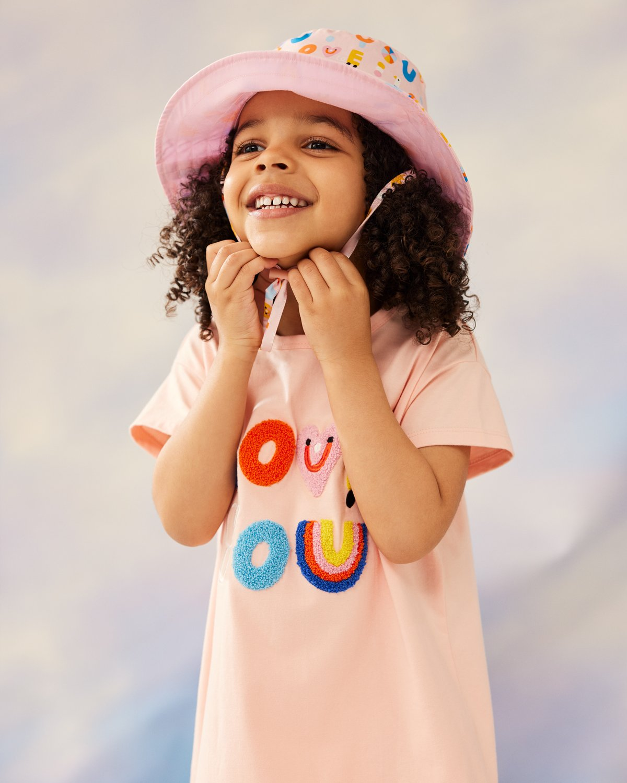 2021, Girls Boucle dress and Sun Hat.