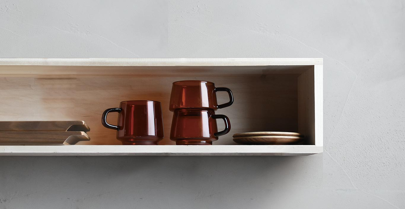 SEPIA mugs in a kitchen cabinet