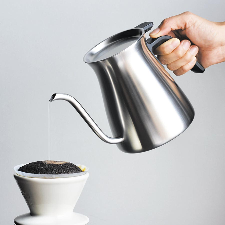 POUR OVER KETTLE pouring water into a coffee brewer