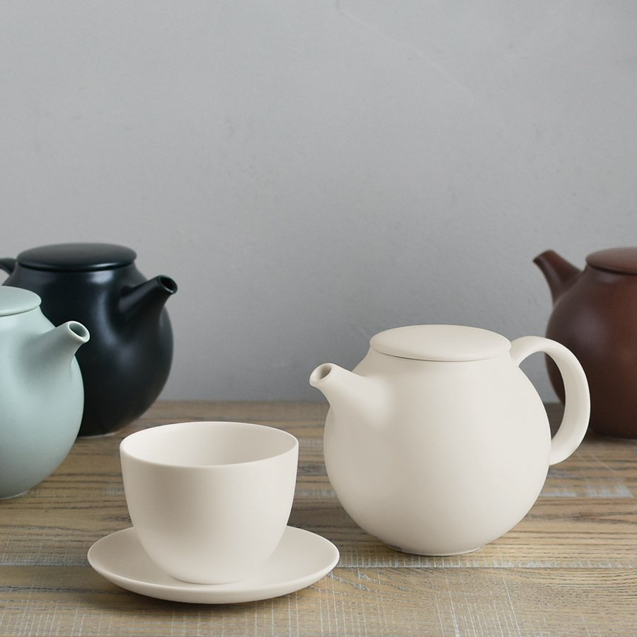 PEBBLE collection of teapot and cup and saucer in white, moss green, and black
