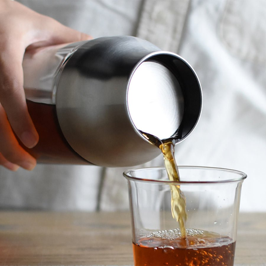 CAPSULE cold brew carafe pouring coffee into CAST green tea cup