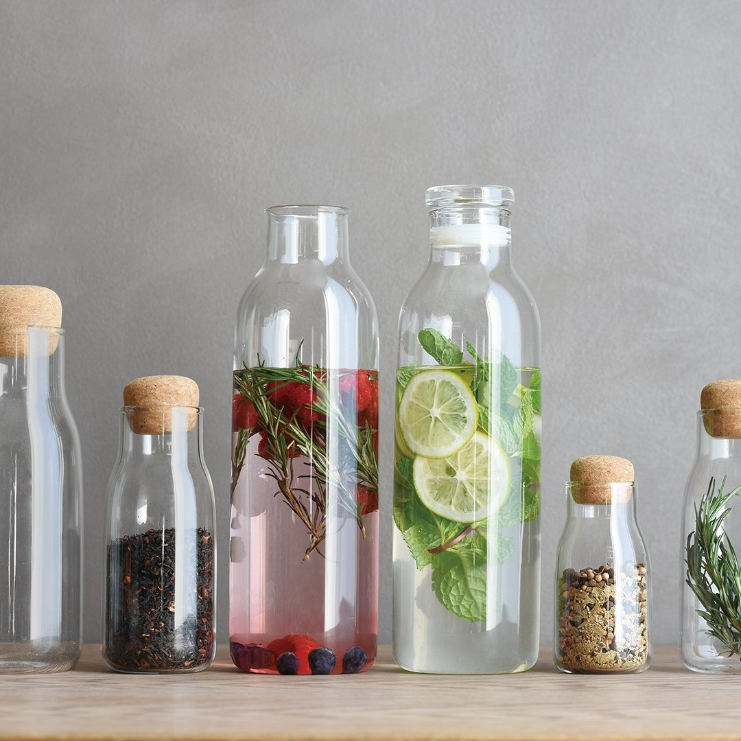 BOTTLIT canisters and BOTTLIT carafe with mint and fruit flavored water