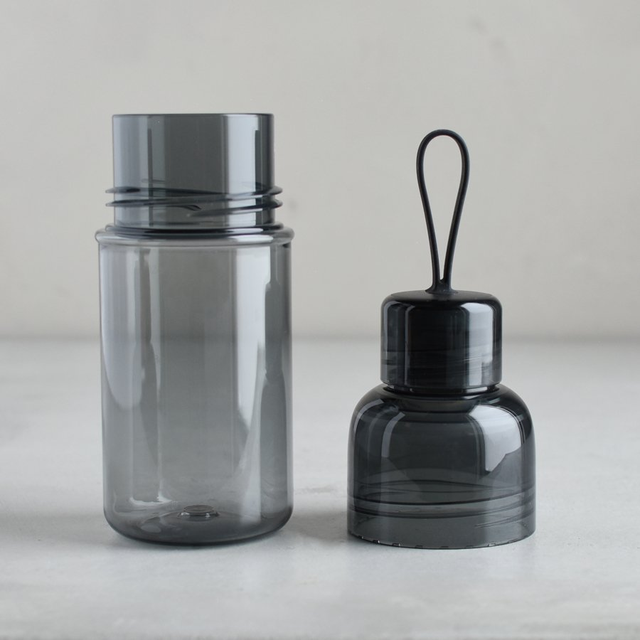 WORKOUT bottle smoke with lid off and placed next to the bottle